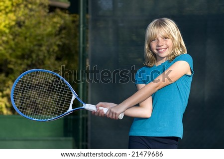 Confident Elementary Age Girl on the Tennis Court