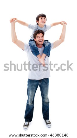 Confident father giving his son piggyback ride against a white background