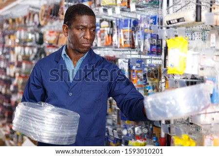 Confident foreman looking for construction supplies for renovation works in household store