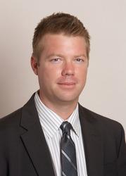 Confident handsome businessman in suit headshot portrait