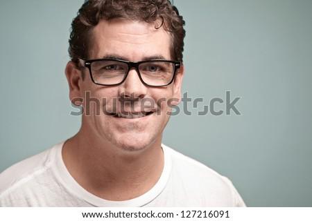 Confident handsome man with glasses closeup portrait - Shutterstock ID 127216091