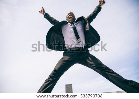Confident happy businessman exulting
