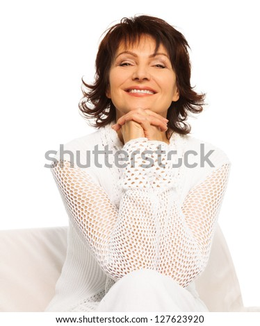 Confident happy senior adult woman sitting and smiling with hands hold together