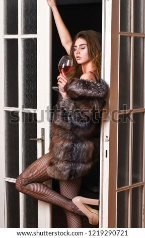 Confident in her magnetism. Seduction art concept. Girl enter bedroom doors. Fashion lady enjoy her seductiveness. Woman seductive appearance. Woman seductive model wear luxury fur and elite lingerie.