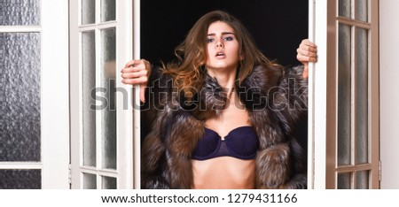 Confident in her magnetism. Woman seductive wear luxury fur and lingerie. Seduction art concept. Female lover enter bedroom doors. Fashion lady confident and seductive. Woman seductive appearance.