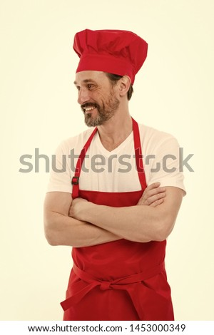 Confident in his culinary skills. Senior cook with beard and moustache wearing bib apron. Mature chief cook in red cooking apron. Bearded mature man in chef hat and apron. Home cooking. #1453000349