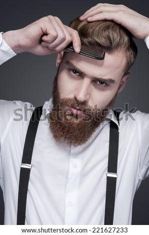 Young Man Comb His Hair On Gray Background Images And Stock