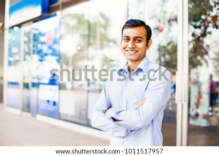 Confident indian man with arms crossed looking at camera