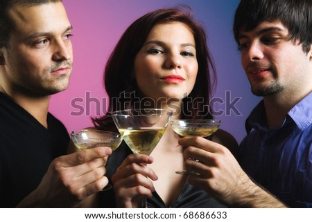 Confident looking woman and two men