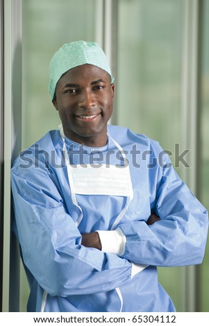 Confident male surgeon smiling at camera
