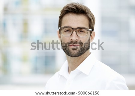 Confident man in glasses looking at camera - Shutterstock ID 500066158