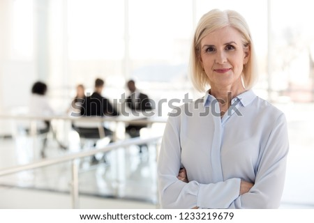 Confident mature businesswoman looking at camera, middle aged company ceo director, experienced senior female professional, old lady business coach team leader posing in office, headshot portrait #1233219679