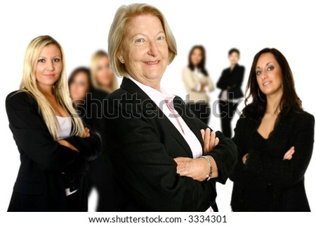 Confident mature female caucasian businesswoman leading a diverse team of female colleagues in the background. Concept of diversity in teamwork.