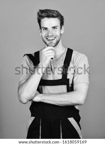 Confident mechanic. man build house. skilled architect repair and fix. building skills and construction. worker purple background. man builder in work clothes. professional repairman. turnkey project.