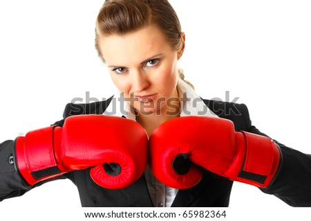 Confident modern business woman with boxing gloves isolated on white