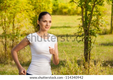 confident morning jogger in the park - stock photo