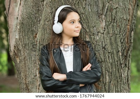 Confident music for confident people. Confident look of music lover. Confident kid keep arms crossed outdoors. Casual fashion trend. Fashion and style. Songs boosting confidence.