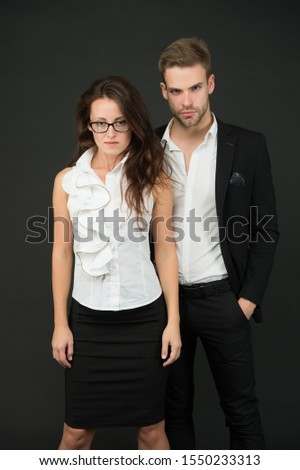 Confident of success. Business partners with confident look. Confident couple in formalwear. Confident in starting business together. Startup.