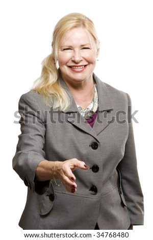 Confident older business woman giving a handshake