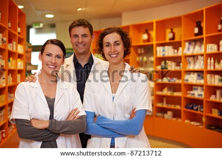 Confident pharmacy team with pharmacist and pharmacy technicians
