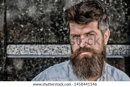 Confident posture of handsome man. Guy masculine appearance with long beard. Barber concept. Beard grooming. Beard care. Masculinity and manliness. Man attractive bearded hipster posing outdoors.