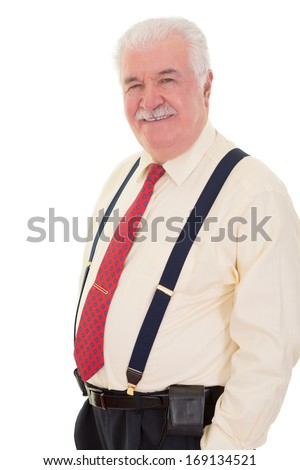 Confident relaxed senior man wearing braces standing smiling at the camera with his hands in his pocket Сток-фото ©