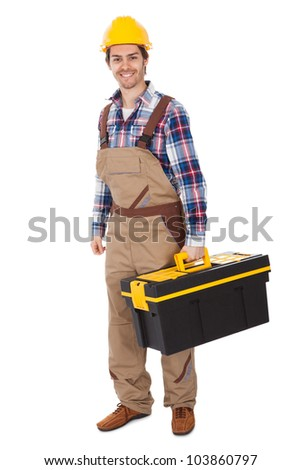 Confident repairman wearing hard hat and holding toolbox. Isolated on white