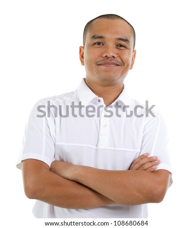 Confident 30s Southeast Asian man crossed arms isolated on white background