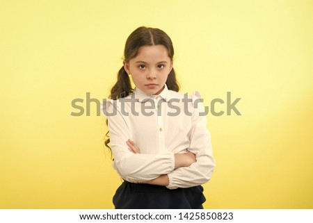 confident schoolgirl. confident and carefree schoolgirl. small schoolgirl with confident look. confident schoolgirl on yellow background #1425850823