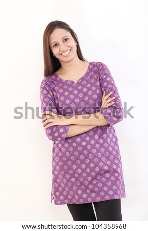 Confident smiling Indian woman with arms crossed - stock photo