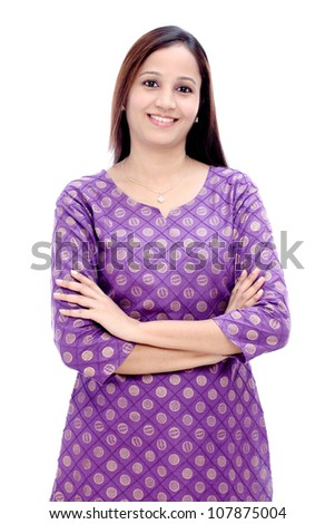 Confident smiling Indian woman with arms crossed