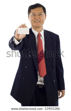 Confident smiling senior Asian business man holding a blank business card, the focus was on the business card.