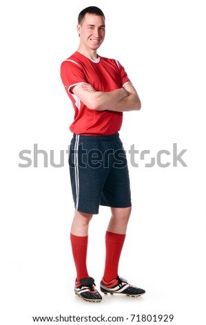confident soccer player with folded hands isolated on white