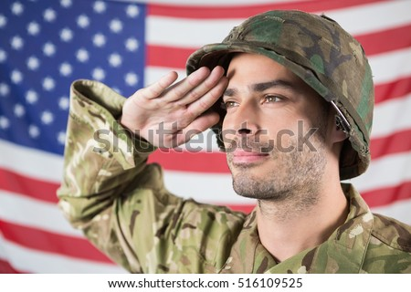 Confident soldier saluting against american flag