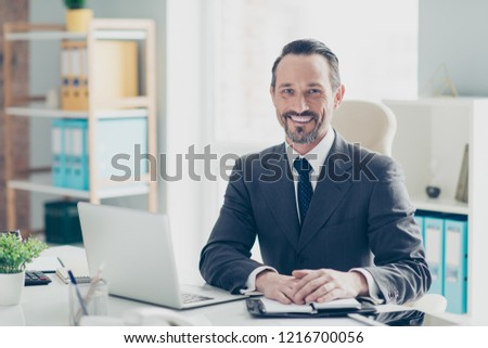 Confident success handsome good-wearing style stylish man in chic formalwear sit on comfort armchair behind desktop in bright white office make beaming toothy smile