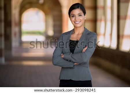 Confident successful smiling business woman executive with folded arms