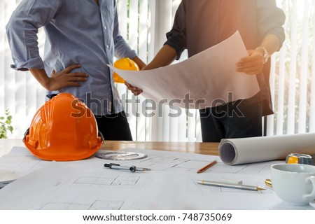 Confident team of architect working together in a office.Then discussing about new startup project on desk. Architect discuss with engineer about project in office, architectural concept stock photo
