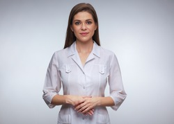 Confident woman doctor wearing medical uniform standing with folded hands. isolated female portrait.