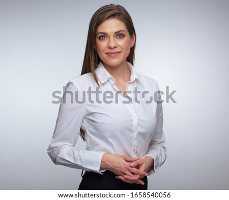 Confident woman in white shirt isolated portrait.