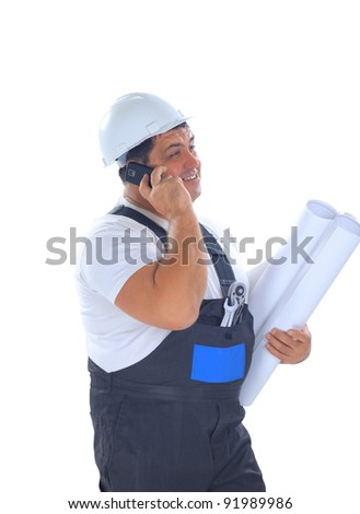 Confident worker with plans talking on mobile phone