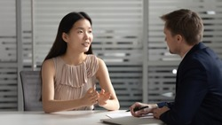 Confident young asian businesswoman applicant manager talk to hr employer consulting customer at job interview meeting, korean seeker speak to recruiter client at hiring negotiation business advice