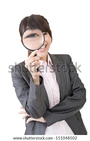 Confident young asian woman looking through a magnifying glass. Isolated on the white background.
