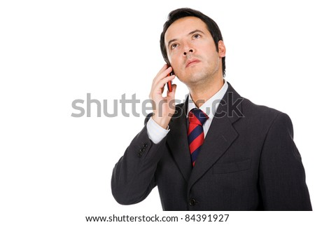 Confident young business man talking on the phone, isolated on white