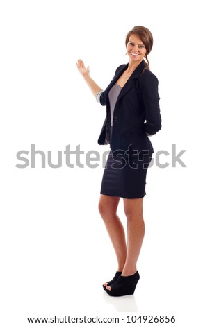 Confident young business woman presenting something isolated over white background