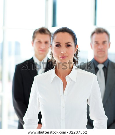 Confident young businesswoman leading her team