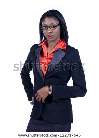 Confident young businesswoman looking at camera over white background