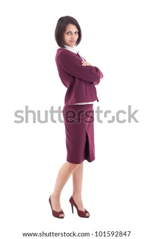 Confident young businesswoman standing arms crossed, looking at camera