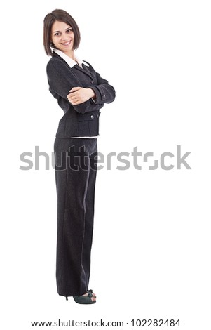 Confident young businesswoman standing arms crossed, looking at camera.
