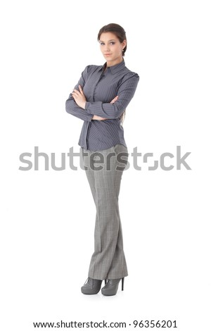 Confident young businesswoman standing arms crossed, looking at camera.?