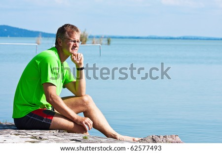 Confident young man on the shores of Lake Balaton
